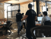 Masked men in VICE Media's Montreal office