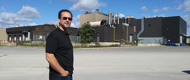 Michael Melo in front of printing plant